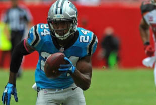 Carolina Panthers cornerback Josh Norman heads for he end zone after intercepting a pass by Tampa Bay Buccaneers quarterback Jameis Winston in the first quarter Sunday. Each big play Norman makes drives up the value of his next contract.